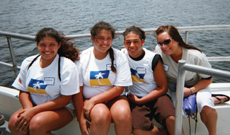 Young caregivers takes a break on an American Association of Caregving deep sea fishing trip.
