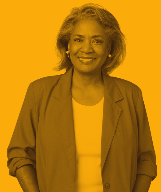 portrait of woman smiling at camera with orange color overlay